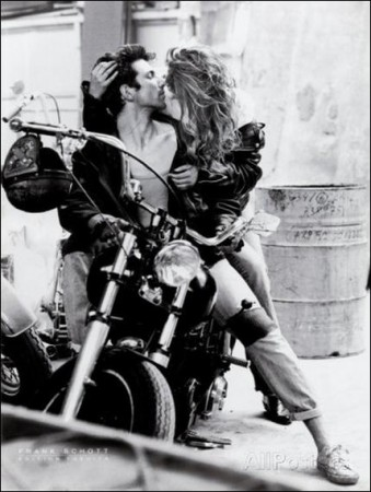 Kissing on Harley Davidson Motorcycle